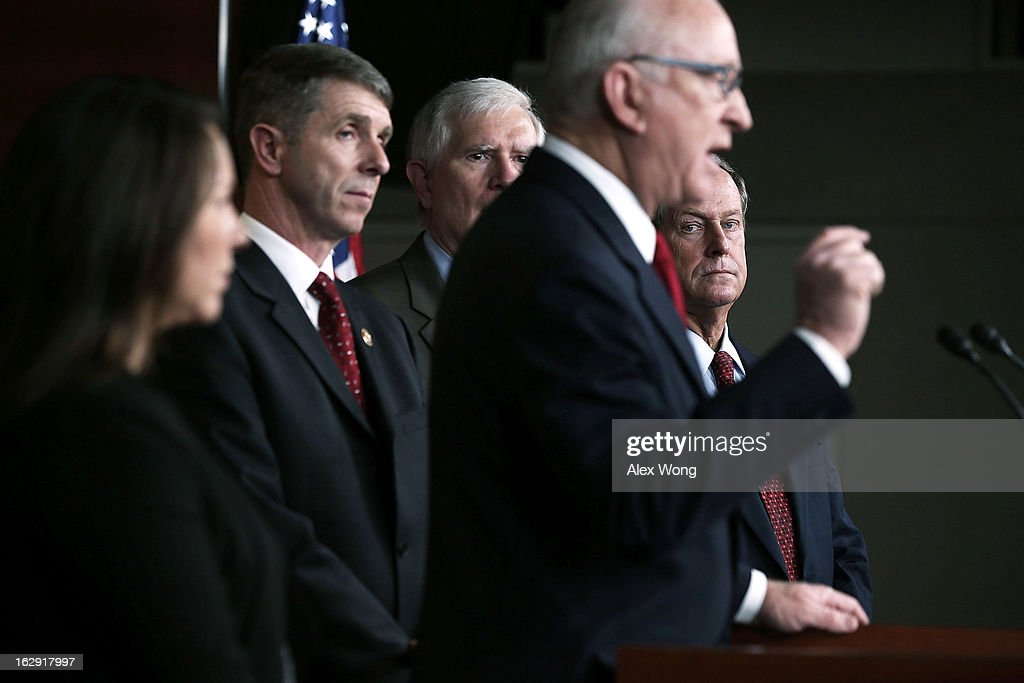 U.S. House Armed Services Committee Chairman U.S. Rep. Howard P. 'Buck' McKeon (R-CA) (4th L) speaks as (L-R) U.S. Rep. Martha Roby (R-AL), U.S. Rep. Rob Whittman (R-VA), U.S. Rep. Mo Brooks (R-AL), and U.S. Rep. Joe Wilson (R-SC) listen during a news conference March 1, 2013 on Capitol Hill in Washington, DC. Members of the House Armed Services Committee held a news conference on 'the day that sequestration will take effect, to call for an end to repeated cuts to our national security and focus on the real drivers of our debt and deficits.'