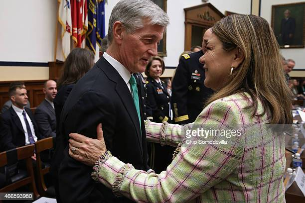 House Armed Services Committee member Rep Loretta Sanchez greets Secretary of the Army John McHugh before a hearing about the FY2016 National Defense...