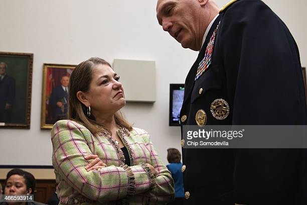 House Armed Services Committee member Rep Loretta Sanchez talks with Army Chief of Staff Gen Raymond Odierno before a hearing about the FY2016...
