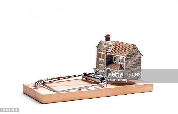 House balancing on mouse trap