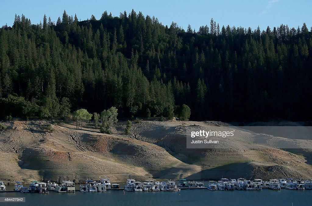 House boats are dwarfed by the steep banks of Shasta Lake at Bridge Bay Resort on August 30 2014 in Redding California As the severe drought in...
