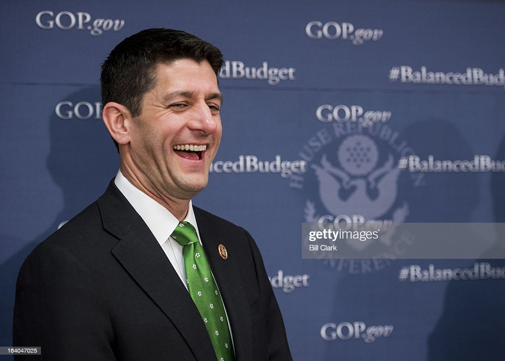 House Budget Committee chairman Paul Ryan, R-Wisc., laughs during the House Republican leadership media availability after the House Republican Conference meeting in the basement of the Capitol on Tuesday, March 19, 2013.