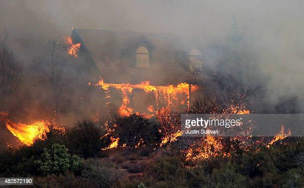 A house burns after being overcome by flames from the Rocky Fire on July 31 2015 in Lower Lake California Over 900 firefighters are battling the...