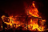 A house burns during the Valley fire in Seigler Springs California on September 13 2015 The governor of California declared a state of emergency...