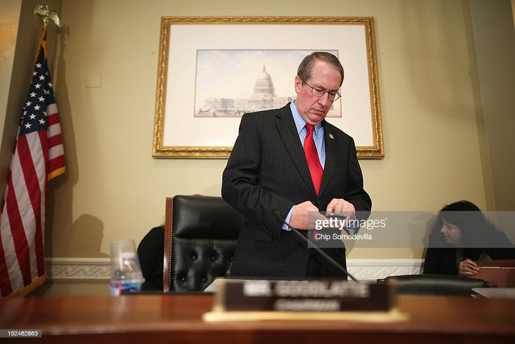 House Committee on Ethics Acting Chairman Bob Goodlatte (R-VA) checks his smartphone before a rare open hearing about the investigation of wrongdoing by Rep. Maxine Waters (D-CA) and her Chief of Staff and grandson Mikael Moore, in the Longworth House Office Building on Capitol Hill September 21, 2012 in Washington, DC. The long-running investigation found that Waters did not commit an ethics violaiton when her office in late 2008 set up a meeting with top Treasury Department officials on behalf of a bank Williams owned stock in, at a time when the bank faced possible collapse because of the financial crisis. However, Moore was issued a letter of reproval for three ethics violations for trying to help the bank.