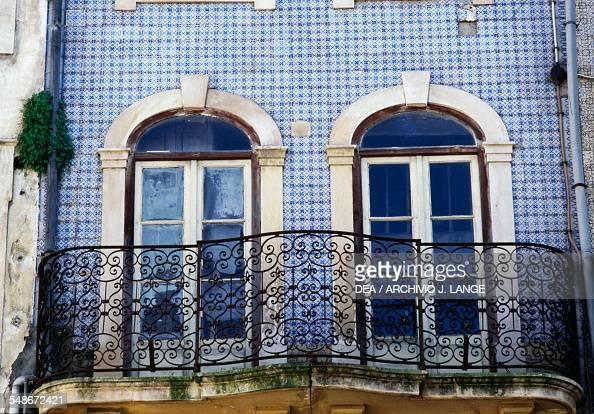 A house covered with azulejo tiles on Praca do Comercio Coimbra Centro Portugal