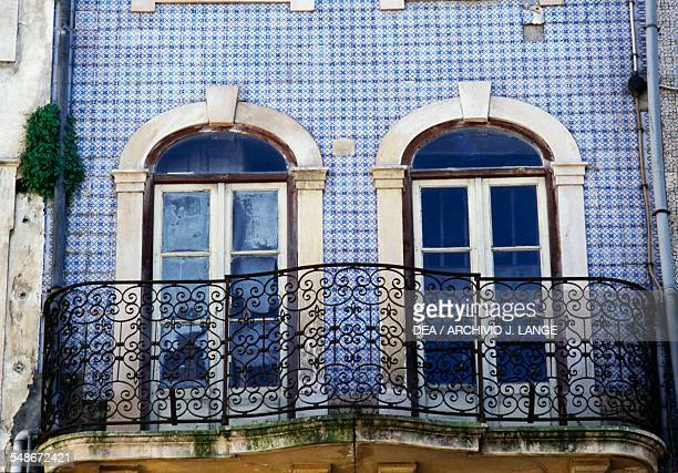 A house covered with azulejo tiles on Praca do Comercio Coimbra Centro Portugal