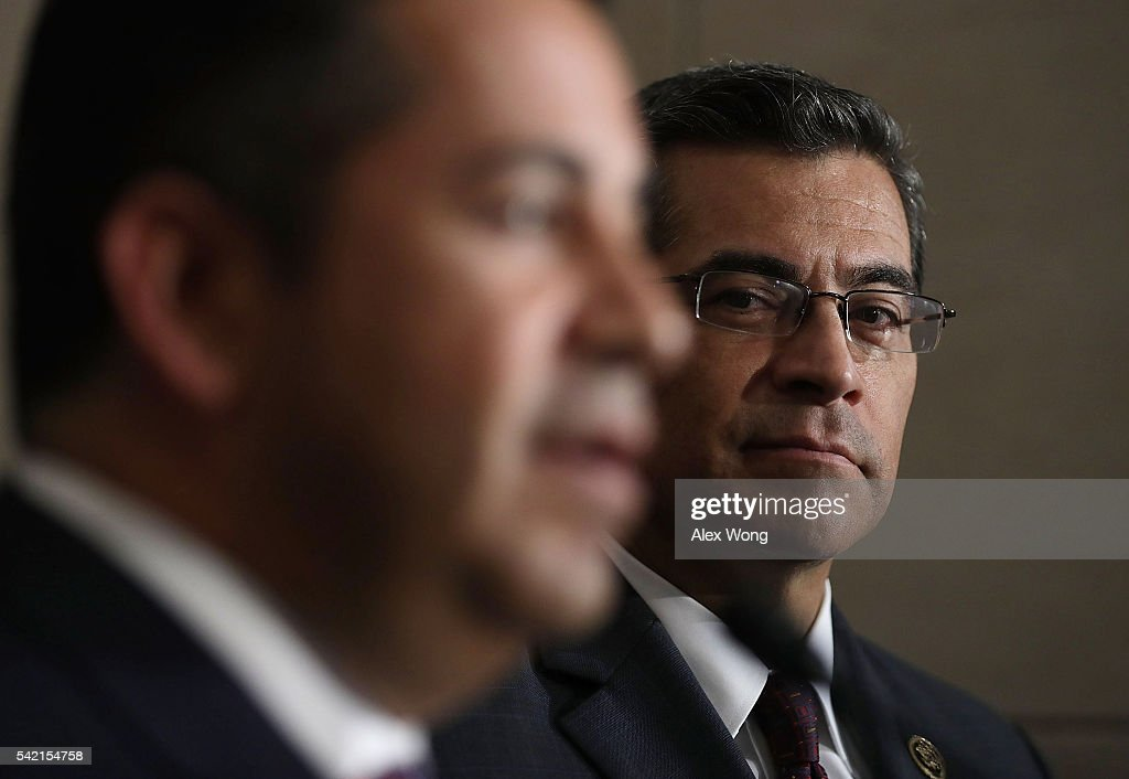 House Democratic Caucus Chair Rep. Xavier Becerra (D-CA) (R) listens as Chairman of Democratic Congressional Campaign Committee Rep. Ben Ray Lujan (D-NM) (L) speaks to members of the media after a House Democratic Caucus meeting June 22, 2016 on Capitol Hill in Washington, DC. Democratic presidential candidate Hillary Clinton joined the House Democratic Caucus meeting as she continued to campaign for the election.