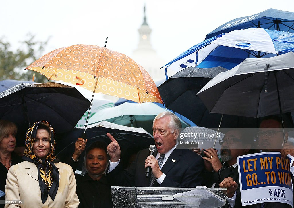 House Democratic Whip Steny Hoyer (D-MD) (3rd R) and House Minority Leader Nancy Pelosi (D-CA) (2nd L) participate in a rally to urge Congress to end the government shutdown, at the U.S. Capitol, October 9, 2013 in Washington, DC. The U.S. government shutdown is entering its tenth day as the U.S. Senate and House of Representatives remain gridlocked on funding the federal government.