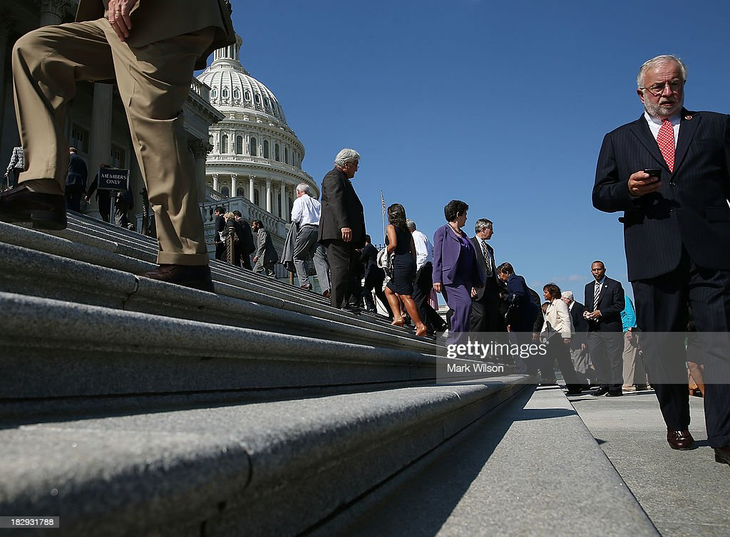 House Democrats walk away after a news conference on the federal government shutdown at the U.S. Capitol on October 2, 2013 in Washington, DC. Later today President Barack Obama will meet with congressional leaders at the White House to discuss an end to the government shutdown.