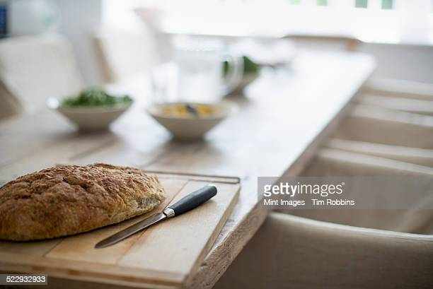 A house dining room. Food on the table. Baked bread.