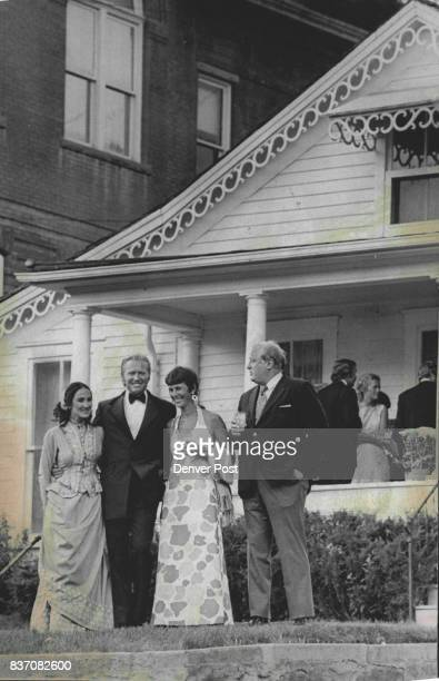 House Donated To Association Mr and Mrs Gerald Hillyard Jr and Mr and Mrs Richard Gibson stand in front of white frame house donated to the Opera...