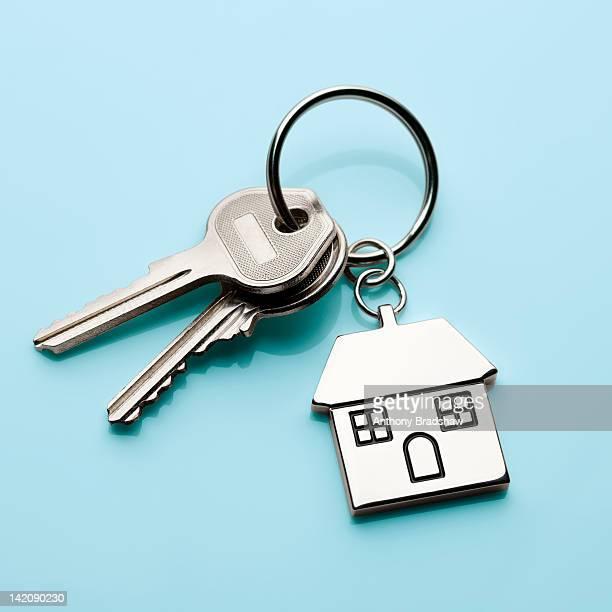 House door keys on cyan