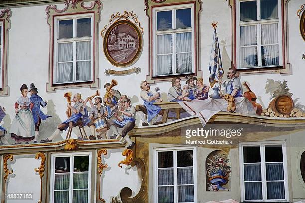 House facade adorned with bavarian themes in 'Luftlmalerei' (wall murals in fresco technique).