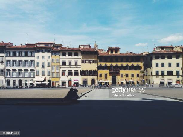 House facades with windows and balconies in Florence (Tuscany, Italy)