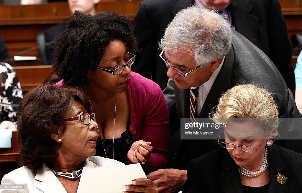 House Finance Committee chair Rep. Barney Frank (D-MA) (2R) confers with Rep. Carolyn Maloney (D-NY) (R), Rep. Maxine Waters (D-CA) (L) and a staff member during the House-Senate Conference Committee meeting on H.R.4173, the 'Wall Street Reform and Consumer Protection Act' June 15, 2010 in Washington, DC. Members of the House and Senate are working to reach a compromise on financial reform legislation that passed their respective legislative bodies.