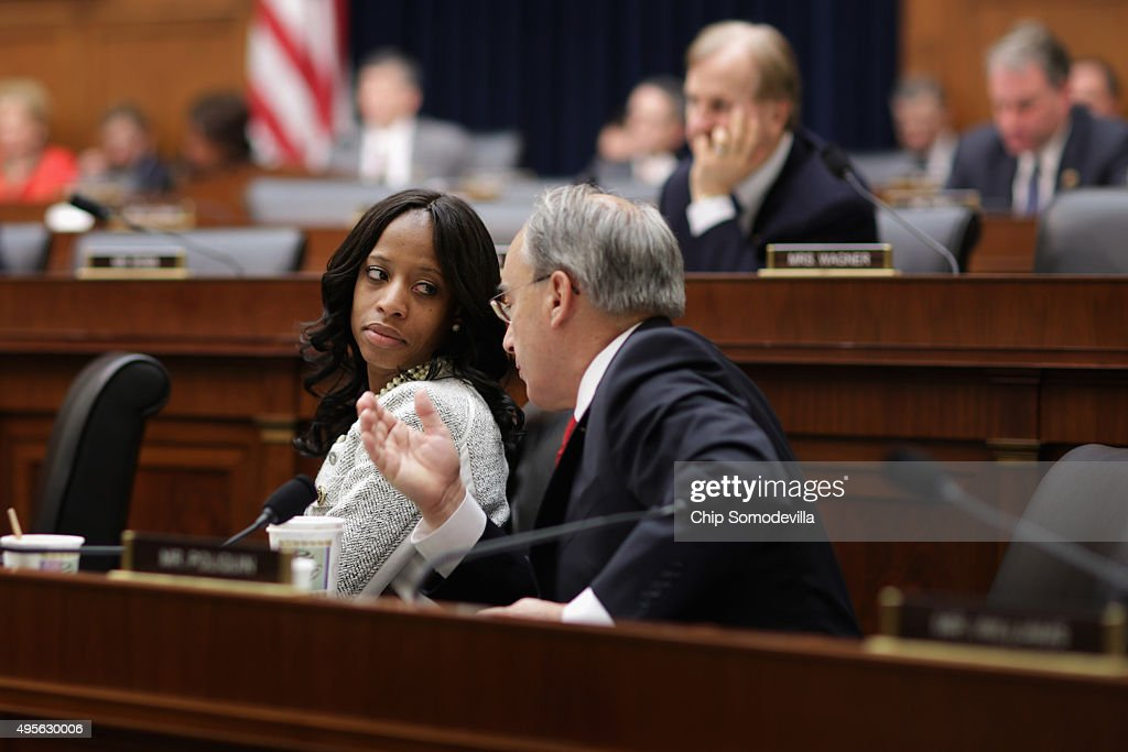 House Finance Committee members Rep. <a gi-track='captionPersonalityLinkClicked' href=/galleries/search?phrase=Mia+Love&family=editorial&specificpeople=8937528 ng-click='$event.stopPropagation()'>Mia Love</a> (R-UT) (L) and Rep. Bruce Poliquin (R-ME) confer while hearing testimony from Federal Reserve Chair Janet Yellen in the Rayburn House Office Building November 4, 2015 in Washington, DC. Because the Obama administration has yet to appoint a vice chairman for supervision at the Federal Reserve -- as madated by the Dodd-Frank Law -- Yellen is assuming the semi-annual duty for reporting to the committee on the Fed's 'supervision and regulation of the financial system.'