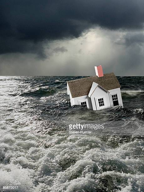 House floating under water in stormy conditions