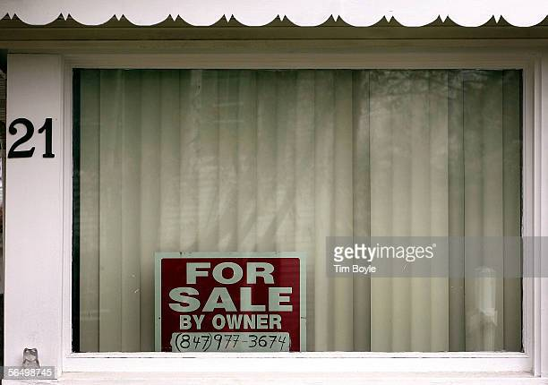 A 'House For Sale' sign is visible in the window of an existing home December 29 2005 in Park Ridge Illinois Sales of existing homes in November fell...