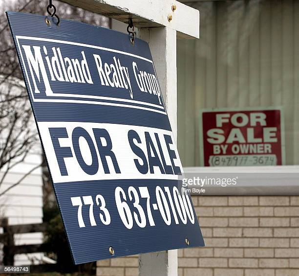 A 'House For Sale' signs are visible in front of an existing home and in the window December 29 2005 in Park Ridge Illinois Sales of existing homes...