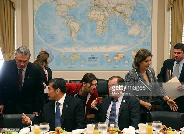House Foreign Affairs Chairman Ed Royce and President of Peru Ollanta Humala sit at a table on Capitol Hill June 12 2013 in Washington DC President...