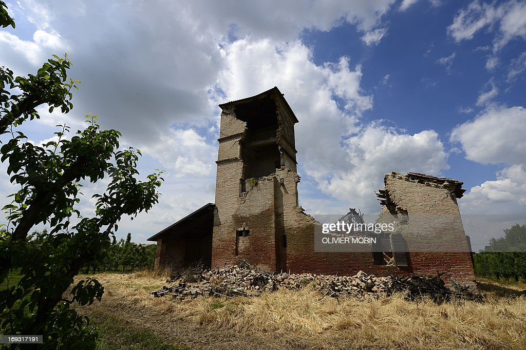 A house from 1562 waits to be restored in a pears tree field outside San Felice sul Panaro on May 22, 2013 a year after an earthquake in the Emilia Romagna. Reconstruction efforts in Emilia Romagna in Italy are proceeding slowly a year after two powerful earthquakes wrecked homes and businesses in this rich farming and medical industry region. AFP PHOTO / OLIVIER MORIN