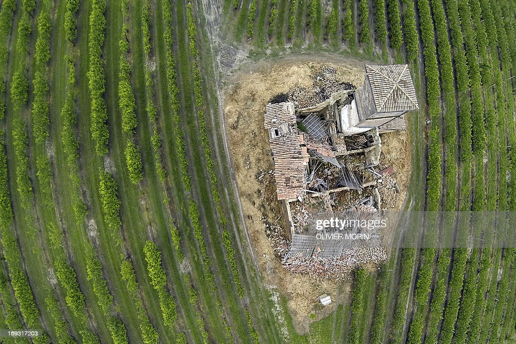 A house from 1562 waits to be restored in a pears tree field outside San Felice sul Panaro on May 22, 2013 a year after an earthquake in the Emilia Romagna. Reconstruction efforts in Emilia Romagna in Italy are proceeding slowly a year after two powerful earthquakes wrecked homes and businesses in this rich farming and medical industry region.
