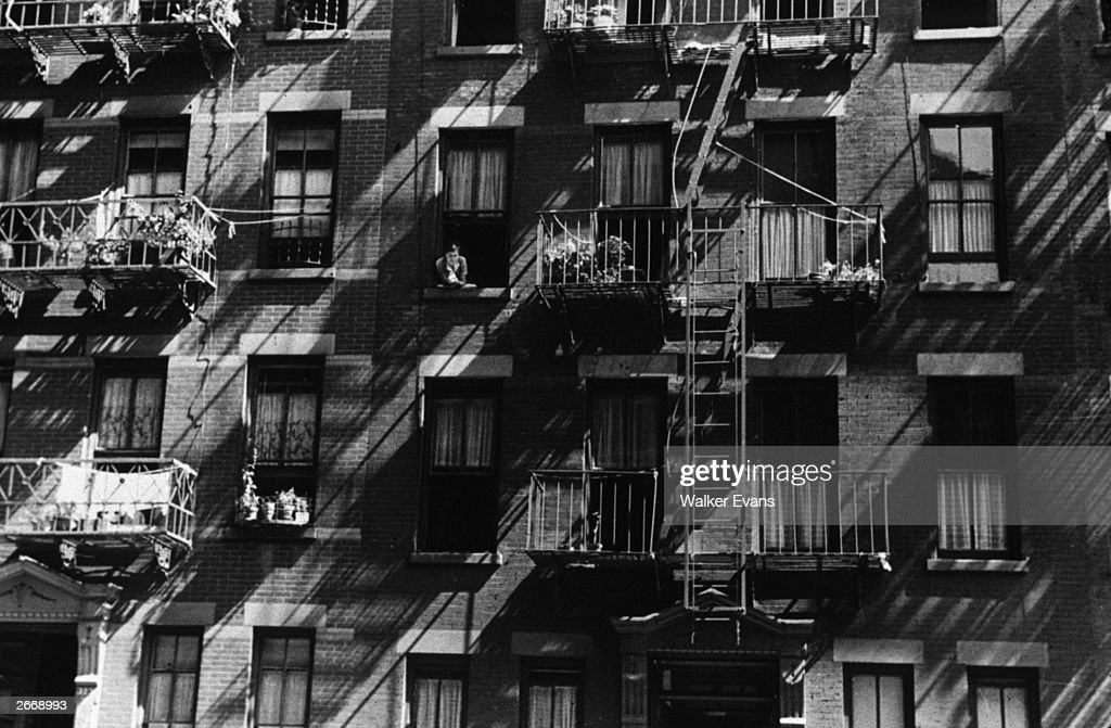 House fronts on 61st Street between First and Third Avenues, New York City.
