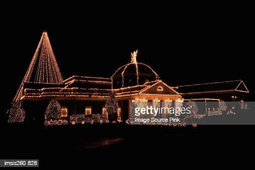House illuminated by christmas lights : Stock Photo