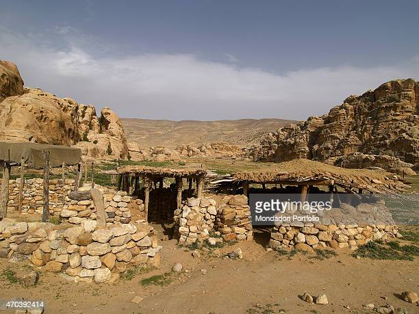 'House in a PrePottery Neolithic Village 72006500 7th6th Millenium BC stone clay and wood building Jordan Petra ElBeidha Archeological site Whole...