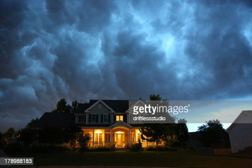 House in bad summer thunderstorm : Stock Photo