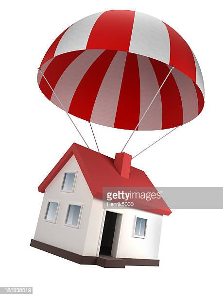 House in parachute - isolated on white with clipping path