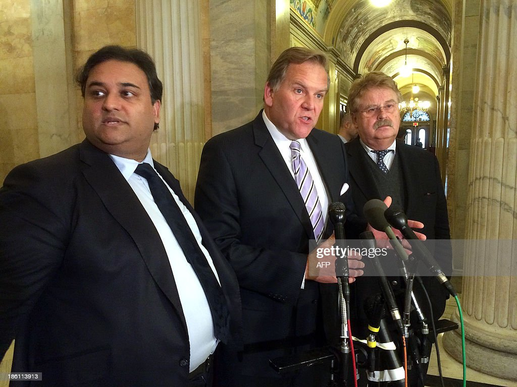 House Intelligence Committee chairman Mike Rogers(C), R-MI, addresses reporters October 28, 2013 at the US Capitol in Washington, DC following meetings with European Parliament members, including Britain's Claude Moraes(L) who leads the parliamentary inquiry on mass surveillance, and Germany's Elmar Brok(R) who chairs the European Parliament's Committee on Foreign Affairs. Decades of mutual trust have been breached and will need repair as a result of mass US eavesdropping on allies, European parliamentarians told a US lawmaker Monday amid a swirling espionage scandal. US House Intelligence Committee chairman Mike Rogers emerged from the one-hour talks to pledge that US lawmakers will travel to Brussels 'very, very soon' for another round of meetings. AFP PHOTO / Michael Mathes