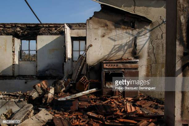 A house is burnt in the village of Travanca do Mondego on October 17 2017 in Coimbra region Portugal At least 37 people have died in fires in...