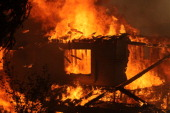 A house is consumed by a wildfire May 14 2014 in San Marcos California About 500 acres have burned in the San Marcos blaze fueled by record heat high...