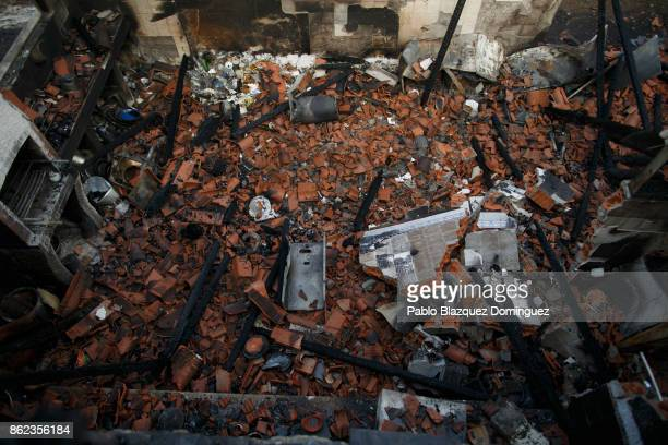 A house is destroyed after a gas bottle exploded during a wildfire near Penacova on October 17 2017 in Coimbra region Portugal At least 37 people...