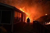 A house is engulfed in flames during the Valley fire in Seigler Springs California on September 13 2015 The governor of California declared a state...