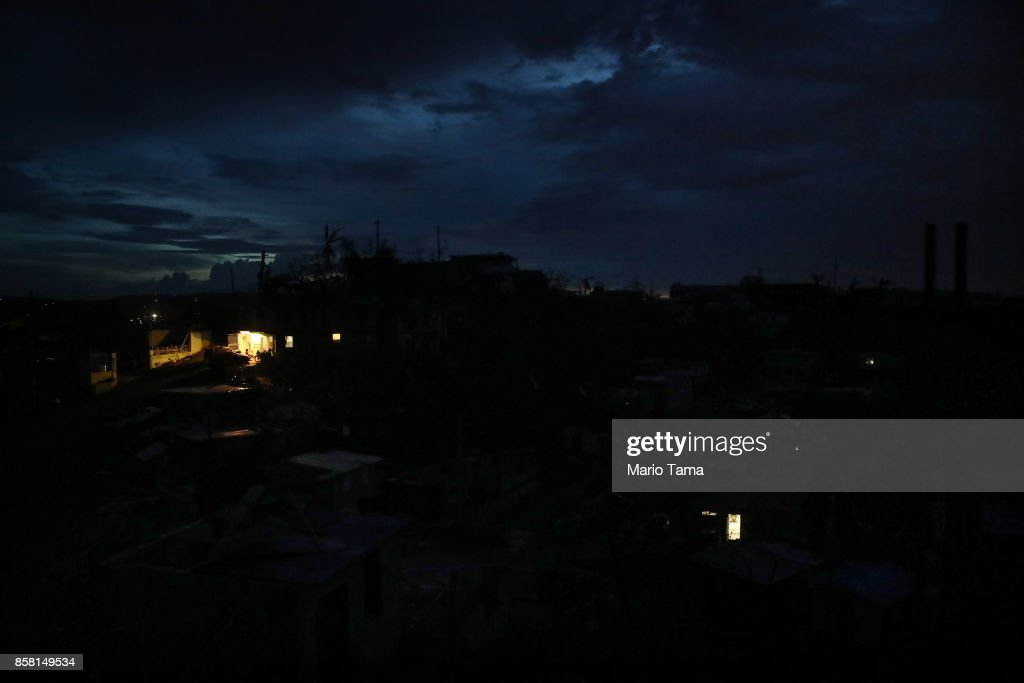 A house (Upper Left) is lit by a generator in a neighborhood without grid power or running water about two weeks after Hurricane Maria swept through the island on October 5, 2017 in San Isidro, Puerto Rico. A few residents have acquired generators for electricity in the area but most homes remain dark. Puerto Rico experienced widespread damage including most of the electrical, gas and water grid as well as agriculture after Hurricane Maria, a category 4 hurricane, swept through.