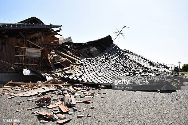 A house is seen collapsed after the earthquake on April 15 2016 in Mashiki Kumamoto Japan As of April 15 morning at least nine people died in the...