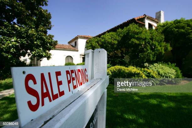 A house is seen with a 'For Sale' sign on it on July 25 2005 in Pasadena California Existing home prices are shooting up at the fastest pace in...