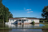 A house is surrounded by flood water after heavy rains on October 6 2015 in Eastover South Carolina The state of South Carolina experienced record...