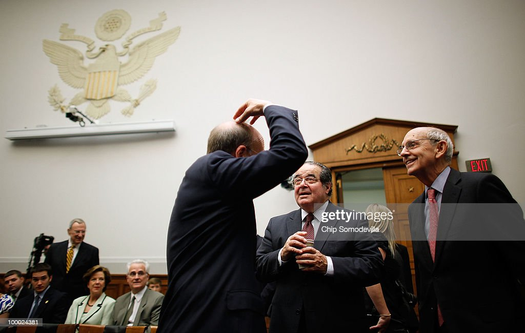 House Judiciary Committee's Commercial and Administrative Law Subcommittee Chairman Rep. Steve Cohen (D-TN) (L) talks with Supreme Court Associate Justice <a gi-track='captionPersonalityLinkClicked' href=/galleries/search?phrase=Stephen+Breyer+-+Judge&family=editorial&specificpeople=227411 ng-click='$event.stopPropagation()'>Stephen Breyer</a> (R) and fellow Associate Justice <a gi-track='captionPersonalityLinkClicked' href=/galleries/search?phrase=Antonin+Scalia&family=editorial&specificpeople=215620 ng-click='$event.stopPropagation()'>Antonin Scalia</a> testifiy before the justices testify before the the subcommittee on Capitol Hill May 20, 2010 in Washington, DC. Breyer and Scalia testified to the subcommittee about the Administrative Conference of the United States.