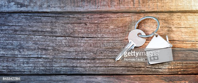 House Key And Keychain On Wooden Table : Stock Photo