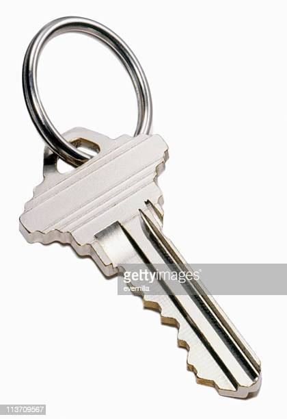 house key cut out on white