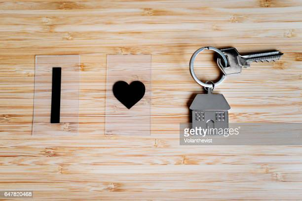 House key on a bamboo table with a heart (I love my home)