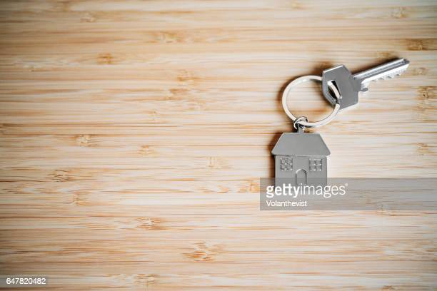 House key on a bamboo table with copy space
