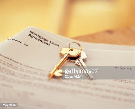 House Keys On Mortgage Agreement