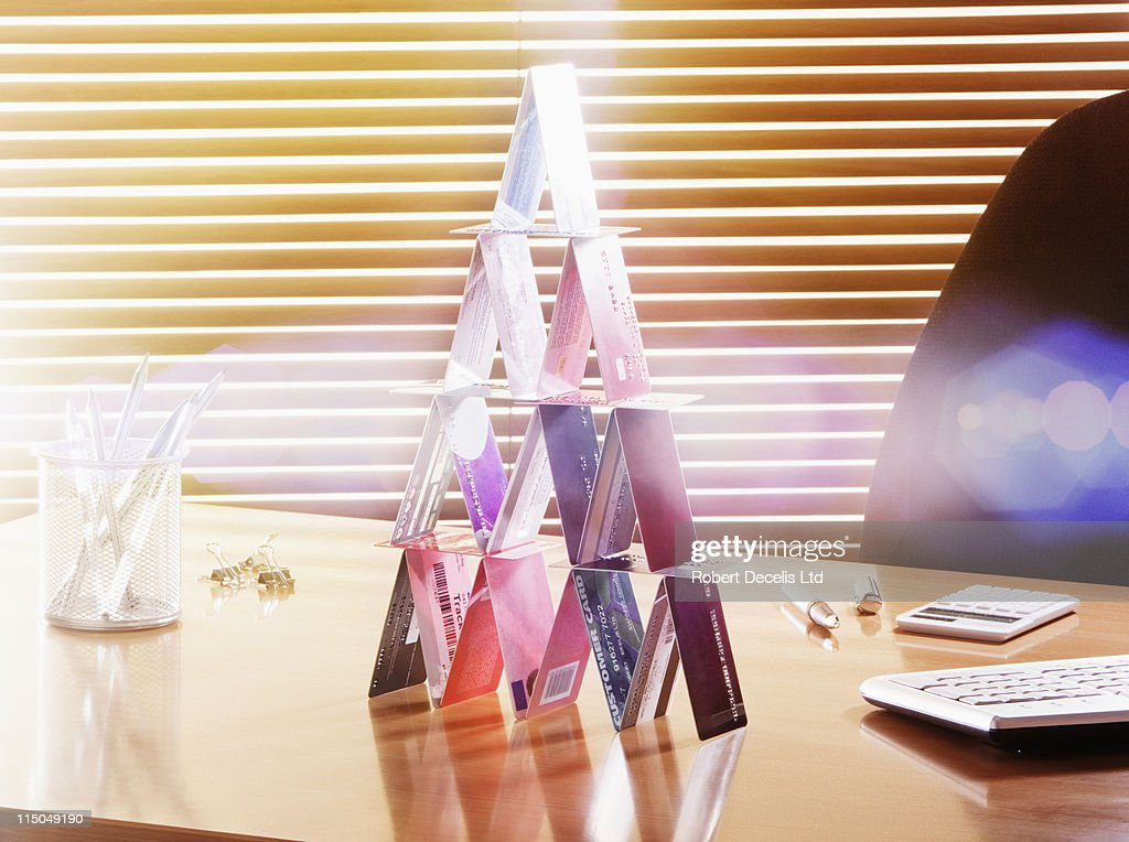 House made of credit cards on work desk. : Stock Photo