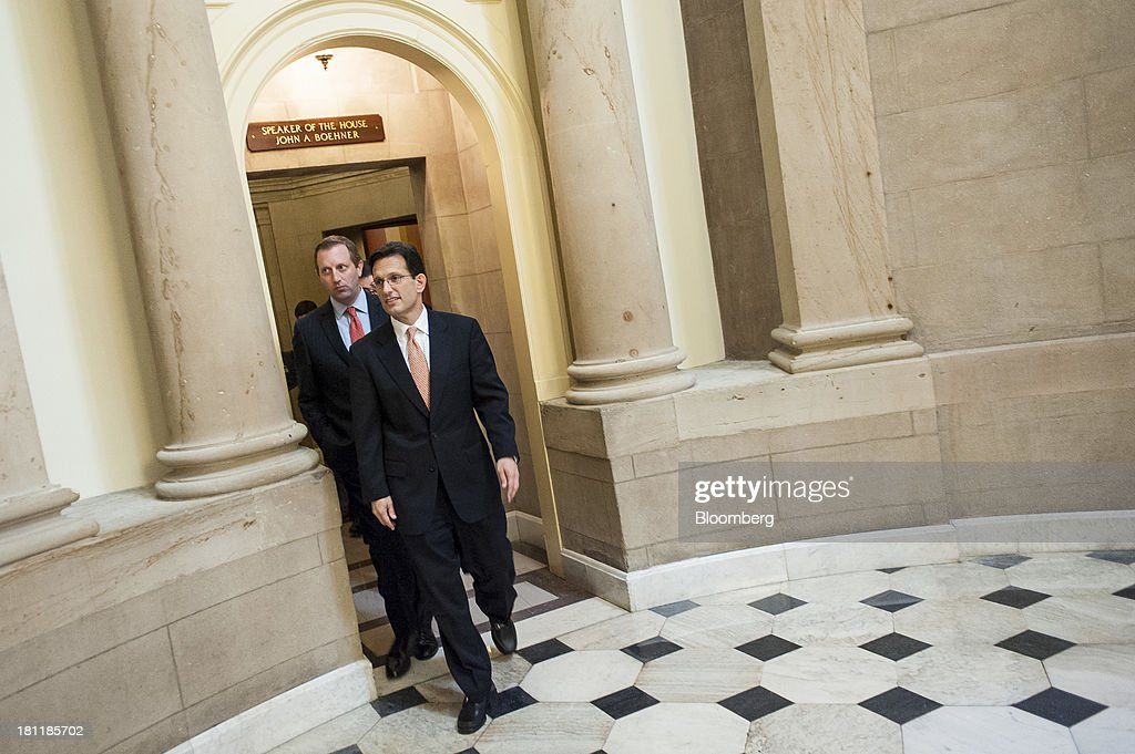 House Majority Leader Eric Cantor, a Republican from Virginia, right, leaves House Speaker John Boehner's office after a meeting with Mark Zuckerberg, founder and chief executive officer of Facebook Inc., not seen, and members of the House Republican Leadership in Washington, D.C., U.S., on Thursday, Sept. 19, 2013. Zuckerberg in April announced the formation of an advocacy group, Fwd.us, to push for more visas for skilled immigrant workers. Photographer: Pete Marovich/Bloomberg via Getty Images