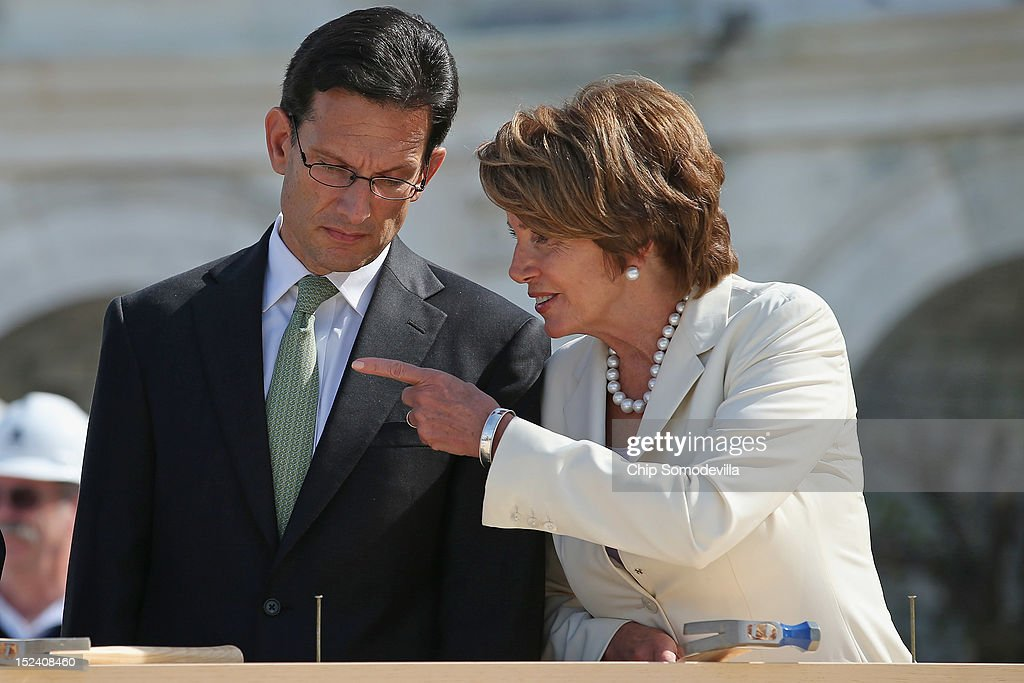House Majority Leader <a gi-track='captionPersonalityLinkClicked' href=/galleries/search?phrase=Eric+Cantor&family=editorial&specificpeople=653711 ng-click='$event.stopPropagation()'>Eric Cantor</a> (R-VA) (L) and House Minority Leader <a gi-track='captionPersonalityLinkClicked' href=/galleries/search?phrase=Nancy+Pelosi&family=editorial&specificpeople=169883 ng-click='$event.stopPropagation()'>Nancy Pelosi</a> (D-CA) (R) talk during the 'First Nail' ceremony, signifying the start of construction of the 2013 Inaugural Platform on the West Front of the U.S. Capitol September 20, 2012 in Washington, DC. The winner of the November 6 presidential election will be sworn in on the platform on January 21, 2013.